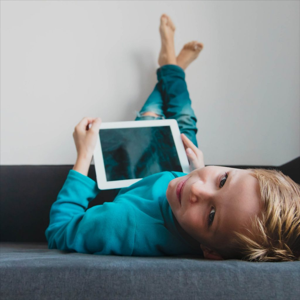 A child using technology for online story time.