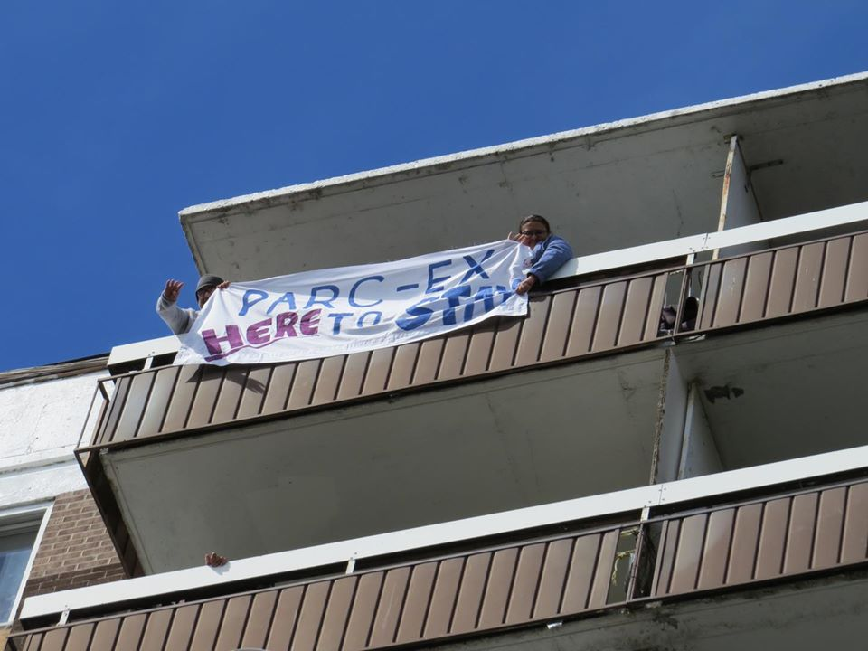 Residents hold up signs saying no to evictions in Park Extension during the caravan protest held on June 11. Photo: CAPE